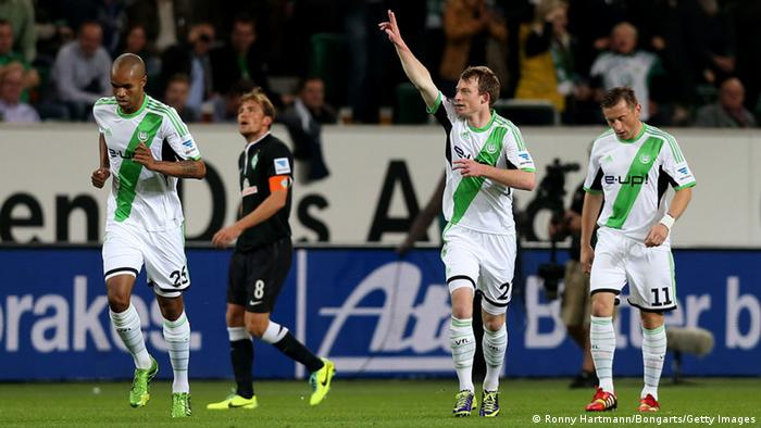 Maximilian Arnold (C) of Wolfsburg celebrates his team's opening goal during its Bundesliga match between VfL Wolfsburg and Werder Bremen at Volkswagen Arena on October 26, 2013 in Wolfsburg, Germany. Photo: Ronny Hartmann/Bongarts/Getty Images