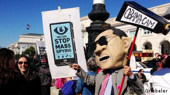 Demonstrators with #stopwatchingus march and hold signs in Washington DC (c) Monika Griebeler