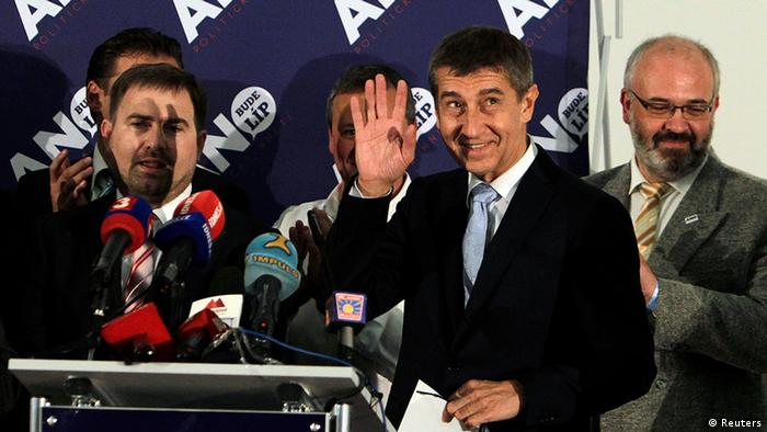 Andrej Babis (2nd R), leader of the ANO movement, gestures as he arrives for a news conference at the party's election headquarters after the country's parliamentary election in Prague October 26, 2013. Czech Social Democrats won most votes in a parliamentary election, partial results showed on Saturday, but their leader predicted tough talks on forming a new coalition government after new protest parties performed well.The newly formed anti-graft protest movement ANO (Yes) led by business tycoon Babis, took second spot with about 19 percent, ahead of the Communists on 16 percent, the partial results showed. REUTERS/David W Cerny (CZECH REPUBLIC - Tags: POLITICS ELECTIONS)