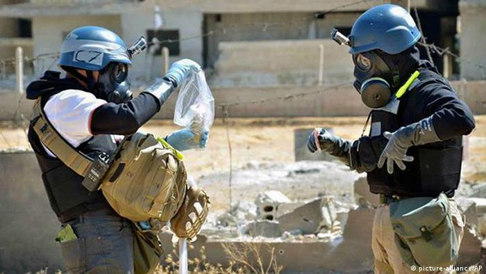 Mideast Syria Chemical Weapons News Guide FILE -- In this Wednesday, Aug. 28, 2013, file photo, a citizen journalism image provided by the United Media Office of Arbeen which has been authenticated based on its contents and other AP reporting, shows members of the UN investigation team take samples from sand near a part of a missile that is likely to be one of the chemical rockets according to activists, in the Damascus countryside of Ain Terma, Syria. The dismantling of Syria's chemical weapons stockpile is under way, but the mission faces multiple challenges, from an ambitious deadline and a raging civil war that threatens inspectors¿ safety. It also has far-reaching political consequences, giving a political boost to President Bashar Assad and further alienating the rebels. (AP Photo/Local Committee of Arbeen, File)