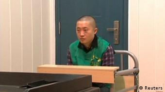 Journalist Chen Yongzhou sits in a detention room at the Changsha Public Security Bureau detention centre in Changsha City, Hunan Province, in this still image taken from China Central Television (CCTV) video shot on October 25, 2013. (Photo: Reuters)