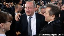 Georgia's Prime Minister Ivanishvili hugs presidential candidate Margvelashvili as they meet with supporters at the Georgian Dream coalition's headquarters in Tbilisi Georgia's Prime Minister Bidzina Ivanishvili (R) hugs presidential candidate Georgy Margvelashvili (C) as they meet with supporters at the Georgian Dream coalition's headquarters in Tbilisi, October 27, 2013. Margvelashvili, an ally of billionaire Ivanishvili, won a landslide victory in a presidential election in Georgia on Sunday, exit polls showed. REUTERS/Grigory Dukor (GEORGIA - Tags: POLITICS ELECTIONS)