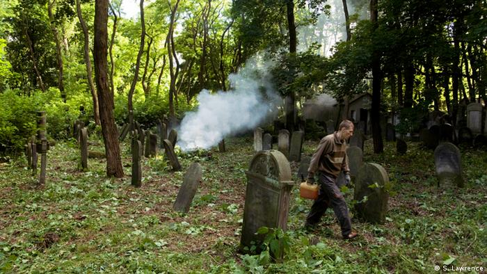 Jewish cemeteries have been largely neglected and become overgrown and forgotten. But recently numerous initiatives have helped to restore the cemeteries, as can be seen on this picture showing a worker who clears brush from the Jewish Cemetery in Warsaw, Poland.
