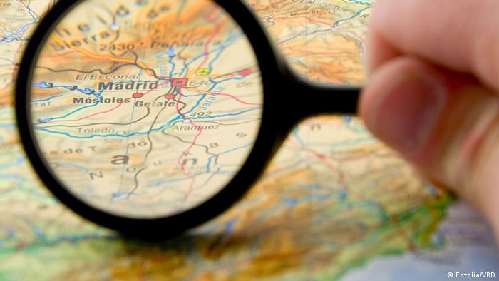 Magnifying glass shown over map of Spain. Fotolia/VRD