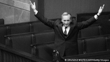 (FILES) -- A file photo taken on September 12, 1989 shows Polish Prime Minister Tadeusz Mazowiecki triumphally saluting deputies from still empty government benches at the Parliament in Warsaw after the election of his cabinet. The Polish Parliament marked on September 11, 2009, the 20th anniversary of the investiture of the first non-Communist government of the Soviet bloc led by Catholic intellectual Tadeusz Mazowiecki. AFP PHOTO / DRUSZCZ WOJTEIC (Photo credit should read DRUSZCZ WOJTEIC/AFP/Getty Images)