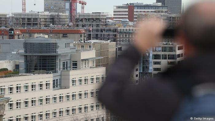 BERLIN, GERMANY - OCTOBER 28: A visitor takes a photo of the U.S. Embassy (L) from the terrace of the Reichstag on October 28, 2013 in Berlin, Germany. The embassy is becoming a focus in the current scandal over eavesdropping by the National Security Agency (NSA) on the mobile phone of German Chancellor Angela Merkel. According to media reports a branch of the NSA called the Special Collection Service operated sophisticated eavesdropping equipment from the embassy building. (Photo by Sean Gallup/Getty Images)