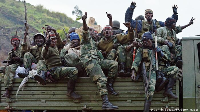 DRC soldiers celebrate a victory over M23 rebels (Photo: CARL DE SOUZA/AFP/Getty Images)