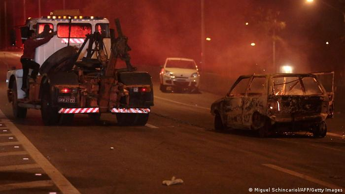 View of a car on fire in a highway in Sao Paulo, on October 28, 2013, following disturbances triggered by the accidental fatal shooting --on the eve-- of a 17-year-old boy by the police. Miguel Schincariol/AFP/Getty Images