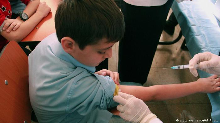 polio vaccine injection Photo: AP/UNICEF, Omar Sanadiki