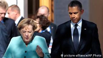 FILE - In this Sept. 6, 2013, file photo, President Barack Obama, right, walks with Germany's Chancellor Angela Merkel prior to a group photo of G-20 leaders outside of the Konstantin Palace in St. Petersburg, Russia. Reports based on leaks from former NSA systems analyst Edward Snowden suggest the U.S. has monitored the telephone communications of 35 foreign leaders. The fact that Merkel was among them has been particularly troubling to many in Europe and on Capitol Hill, given her status as a senior stateswoman, the leader of Europe¿s strongest economy, and a key American ally on global economics, Iranian nuclear negotiations and the Afghanistan war. (AP Photo/Ivan Sekretarev, File)