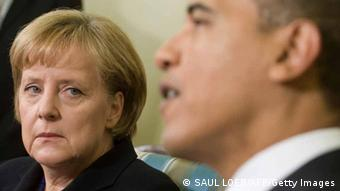 US President Barack Obama meets with German Chancellor Angela Merkel in the Oval Office of the White House in Washington, DC, November 3, 2009. Merkel, in her first US trip since winning a second term in September, was to address the US Congress on the future of transatlantic ties and the demise of European communism, two decades after the fall of the Berlin Wall. (Photo credit should read SAUL LOEB/AFP/Getty Images)