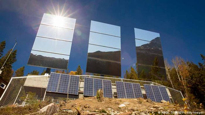 Three giant mirrors erected on the mountainside above Rjukan, Norway, reflect sunshine (photo: MEEK, TORE/AFP/Getty Images)