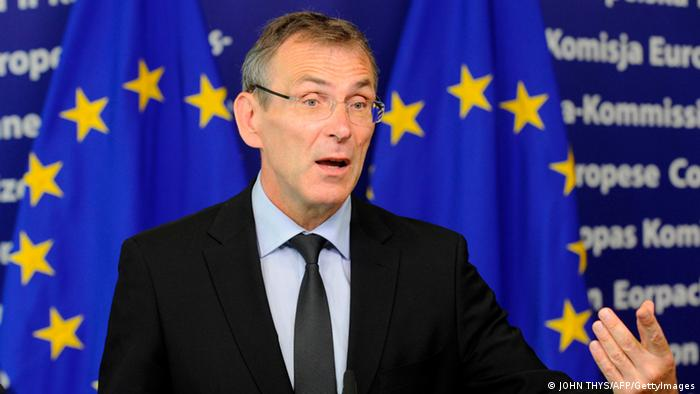 EU Development Commissioner Andris Piebalgs in front of the EU flag JOHN THYS/AFP/GettyImages)