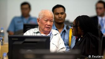 Khmer Rouge former president Khieu Samphan (front L) is seen at the Extraordinary Chambers in the Courts of Cambodia (ECCC), on the outskirts of Phnom Penh in this handout picture dated October 31, 2013. The Khmer Rouge war crimes tribunal is hearing closing arguments in the court's biggest case - known as Case 002 - after lengthy hearings into one of the darkest chapters of the 20th century. Between 1.7 and 2.2 million people died between 1975 and 1979 under the ultra-Maoist Khmer Rouge regime. The case's remaining defendants in the court - ''Brother Number Two'' Nuon Chea and ex-president Khieu Samphan - will make their presentations in response to criminal charges - crimes against humanity in relation to the alleged forced evacuation of population out of cities and the alleged execution of former government soldiers when they took over in 1975. REUTERS/Mark Peterson/ECCC/Handout via Reuters (CAMBODIA - Tags: POLITICS CONFLICT CRIME LAW) ATTENTION EDITORS - THIS IMAGE WAS PROVIDED BY A THIRD PARTY. FOR EDITORIAL USE ONLY. NOT FOR SALE FOR MARKETING OR ADVERTISING CAMPAIGNS. THIS PICTURE IS DISTRIBUTED EXACTLY AS RECEIVED BY REUTERS, AS A SERVICE TO CLIENTS. NO SALES. NO ARCHIVES
