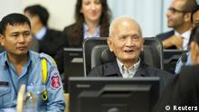 Former Khmer Rouge leader ''Brother Number Two'' Nuon Chea (C), is seen at the Extraordinary Chambers in the Courts of Cambodia (ECCC), in the outskirts of Phnom Penh in this handout picture dated October 31, 2013. Khmer Rouge war crimes tribunal is hearing closing arguments in the court's biggest case - known as Case 002 - after lengthy hearings into one of the darkest chapters of the 20th century. Between 1.7 and 2.2 million people died between 1975 and 1979 under the ultra-Maoist Khmer Rouge regime. The case's remaining defendants in the court - ''Brother Number Two'' Nuon Chea and ex-president Khieu Samphan - will make their presentations in response to criminal charges - crimes against humanity in relation to the alleged forced evacuation of population out of cities and the alleged execution of former government soldiers when they took over in 1975. REUTERS/Mark Peters/ECCC/Handout via Reuters (CAMBODIA - Tags: POLITICS CONFLICT CRIME LAW) ATTENTION EDITORS - NO SALES. NO ARCHIVES. FOR EDITORIAL USE ONLY. NOT FOR SALE FOR MARKETING OR ADVERTISING CAMPAIGNS. THIS IMAGE HAS BEEN SUPPLIED BY A THIRD PARTY. IT IS DISTRIBUTED, EXACTLY AS RECEIVED BY REUTERS, AS A SERVICE TO CLIENTS