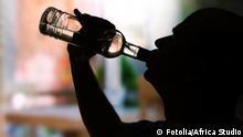 Silhouette of man drinking alcohol, close up 49383107
