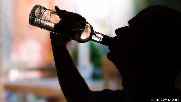 Man drinking from a bottle