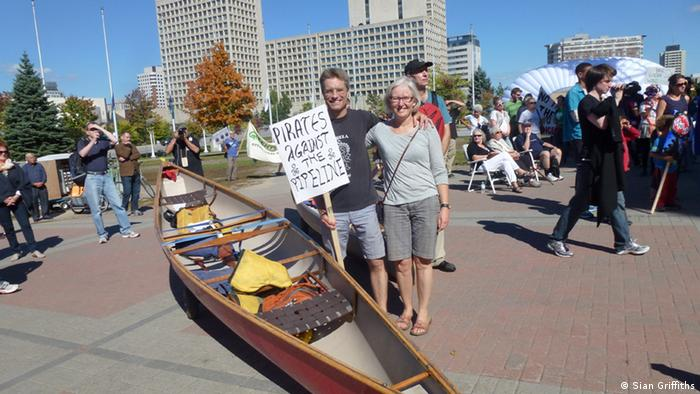 Mary O'Neill and her husband protest at Ottawa City Hall about the Energy East pipeline