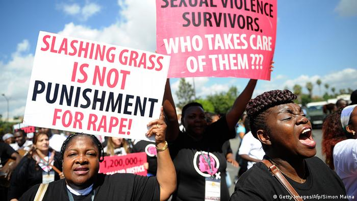 Kenyan protestors march towards the police headquarters on October 31, 2013 in Nairobi to deliver a petition of over a million names demanding justice after men accused of brutally gang raping a schoolgirl cut grass as punishment.SIMON MAINA/AFP/Getty Images