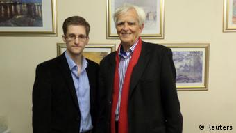 German Greens lawmaker Hans-Christian Stroebele poses for a picture with fugitive former U.S. spy agency contractor Edward Snowden (L) in an undisclosed location in Moscow, October 31, 2013. Stroebele met Snowden in Moscow on Thursday, Stroebele's office said in a statement, and would give details of the meeting on Friday. Snowden passed on an envelope with a letter addressed to the German government, Germany's lower house of parliament, the Bundestag, and to the Federal Public Prosecutor (Generalbundesanwalt). The letter is to be disclosed during a news conference on Friday in Berlin. REUTERS/Handout THIS IMAGE WAS PROVIDED BY A THIRD PARTY. NO SALES. NO ARCHIVES. FOR EDITORIAL USE ONLY. NOT FOR SALE FOR MARKETING OR ADVERTISING CAMPAIGNS. THIS PICTURE IS DISTRIBUTED EXACTLY AS RECEIVED BY REUTERS, AS A SERVICE TO CLIENTS