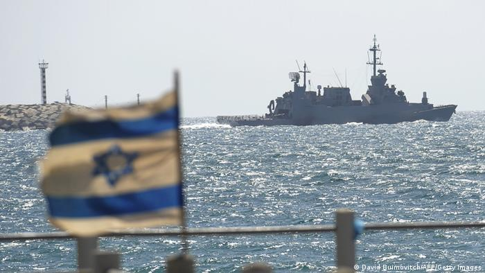 Israeli flag flutters before Israel warship leaving port. DAVID BUIMOVITCH/AFP/Getty Images