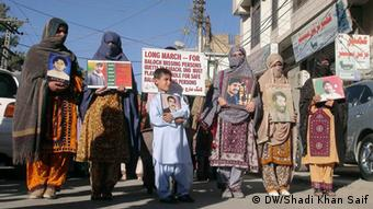 Baloch women holding pictures of their missing relatives at the start of long march in Quetta on Monday, 28 october, 2013(Photo: Shadi Khan Saif/DW)