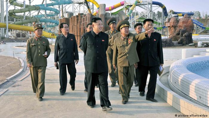 North Korean leader Kim Jong-il (C) touring the construction site of the Munsu Swimming Complex (Photo: EPA/KCNA SOUTH KOREA)