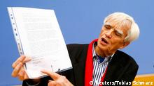 German Greens lawmaker Hans-Christian Stroebele points at the signature on a letter he received from fugitive former U.S. spy agency contractor Edward Snowden, at a news conference in Berlin, November 1, 2013. Stroebele met Snowden in Moscow on Thursday, Stroebele's office said in a statement, and would give details of the meeting on Friday. REUTERS/Tobias Schwarz (GERMANY - Tags: POLITICS CRIME LAW TPX IMAGES OF THE DAY)