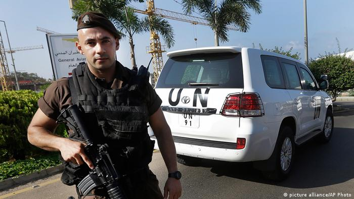 "A Lebanese special forces policeman escorts the vehicles of U.N. experts on the arrival at the private jet terminal, at Beirut international airport, Lebanon, Saturday, Aug. 31, 2013. The U.N. experts investigating last week's alleged chemical weapons strike outside Damascus left Syria early Saturday and crossed into neighboring Lebanon, departing hours after President Barack Obama said he is weighing ""limited and narrow"" action against a Syrian regime that the administration has bluntly accused of launching the deadly attack. (AP Photo/Hussein Malla)"