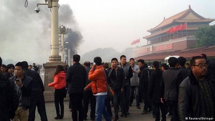People walk along the sidewalk of Chang'an Avenue as smoke raises in front of the main entrance of the Forbidden City at Tiananmen Square in Beijing People walk along the sidewalk of Chang'an Avenue as smoke raises in front of the main entrance of the Forbidden City at Tiananmen Square in Beijing October 28, 2013. Five people were killed and dozens injured on Monday, the government said, when a car ploughed into pedestrians and caught fire in Beijing's Tiananmen Square, the site of 1989 pro-democracy protests bloodily suppressed by the military. Chinese Foreign Ministry spokeswoman Hua Chunying, asked whether the government believed the incident was a terror attack, said she did not know the specifics of the case and declined further comment. REUTERS/Stringer (CHINA - Tags: DISASTER POLITICS) CHINA OUT. NO COMMERCIAL OR EDITORIAL SALES IN CHINA
