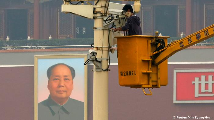 A man works on a security camera that was installed at Tiananmen Square in Beijing, November 1, 2013. China's domestic security chief believes a fatal vehicle crash in Beijing's Tiananmen Square in which five died was planned by a Uighur separatist group, designated as a terrorist organization by the United States and United Nations. Meng Jianzhu, a member of the 25-member Politburo responsible for domestic security, said the East Turkestan Islamic Movement was behind the attack. This is the first time Beijing has accused the group of carrying out the attack. REUTERS/Kim Kyung-Hoon (CHINA - Tags: CRIME LAW POLITICS CIVIL UNREST)