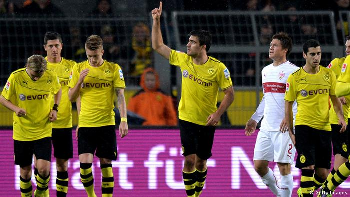 DORTMUND, GERMANY - NOVEMBER 01: Sokratis (C) of Dortmund celebrates after scoring his team's first goal with team mates during the Bundesliga match between Borussia Dortmund and VfB Stuttgart at Signal Iduna Park on November 1, 2013 in Dortmund, Germany. (Photo by Sascha Steinbach/Bongarts/Getty Images)
