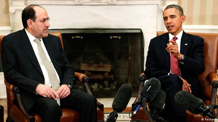 U.S. President Barack Obama (R) and Iraq's Prime Minister Nuri al-Maliki (L) talk to reporters in the Oval Office after meeting at the White House in Washington, November 1, 2013. REUTERS/Jonathan Ernst (UNITED STATES - Tags: POLITICS)