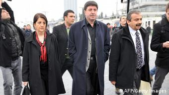Peace and Democracy Party (BDP) members of the parliament Pervin Buldan (L), Altan Tan (C) and Sirri Sureyya Onder (R) are pictured prior to getting on a boat to Imrali island in Istanbul, on February 23, 2013, prior to a meeting with jailed leader of PKK, Abdullah Ocalan, kept in prison on the island, as part of ongoing peace talks to disarm the PKK. AFP PHOTO/OZAN KOSE (Photo credit should read OZAN KOSE/AFP/Getty Images)