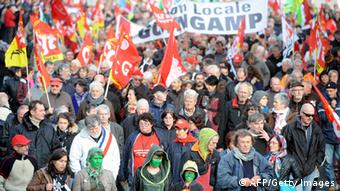 Protesters take part in a demonstration organised by unions against job losses in Brittany in Carhaix-Plouguer, western France, on November 2, 2013. Brittany's farming and food industry, which accounts for a third of local jobs, has been badly hit by France's economic crisis. AFP PHOTO/ JEAN-FRANCOIS MONIER (Photo credit should read JEAN-FRANCOIS MONIER/AFP/Getty Images)