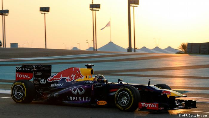 Red Bull's German driver Sebastian Vettel leads after the start of the Abu Dhabi Formula One Grand Prix at the Yas Marina circuit in Abu Dhabi on November 3, 2013. AFP PHOTO / TOM GANDOLFINI (Photo credit should read Tom Gandolfini/AFP/Getty Images)