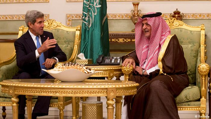 U.S. Secretary of State John Kerry (L) is traditionally welcomed with coffee from Saudi Foreign Minister