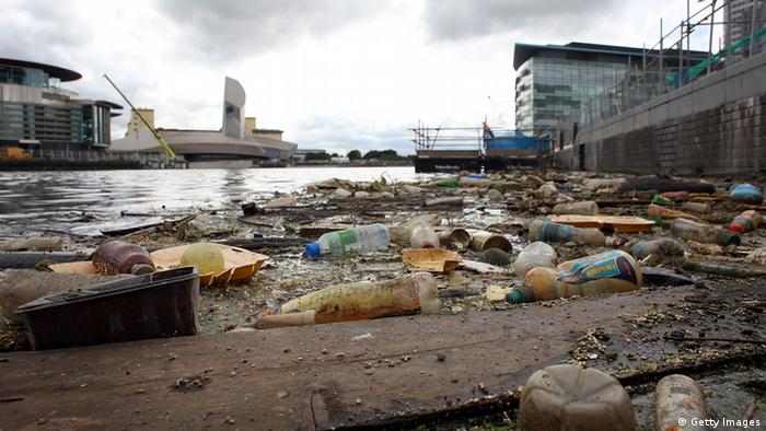 SALFORD, ENGLAND - JULY 27: Plastic bottles, footballs and floating rubbish pollutes Manchester Ship Canal at Salford Quays on July 27, 2010 in Salford, England. (Photo by Christopher Furlong/Getty Images)