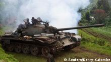 A Congolese army tank moves into position as they advance against the M23 rebels near the Rumangabo military base in Runyoni, 58 km (36 miles) north of Goma, October 31, 2013. Congo's army said on Thursday it was hunting rebels deep in the forests and mountains along the border with Rwanda and Uganda, the insurgents' last hideouts after they were driven from towns they seized during a 20-month rebellion. Picture taken October 31, 2013. REUTERS/Kenny Katombe (DEMOCRATIC REPUBLIC OF CONGO - Tags: SOCIETY CIVIL UNREST POLITICS MILITARY)