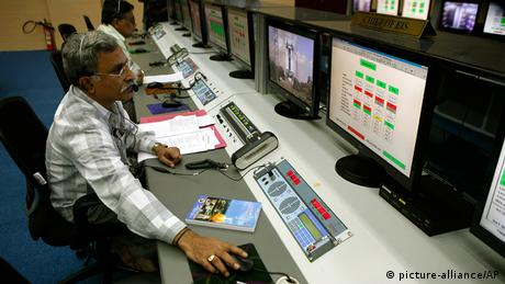 A technician monitors the functions of the Polar Satellite Launch Vehicle (PSLV-C25) at the Satish Dhawan Space Center at Sriharikota, in the southern Indian state of Andhra Pradesh, Wednesday, Oct. 30, 2013. (AP Photo/Arun Sankar K)