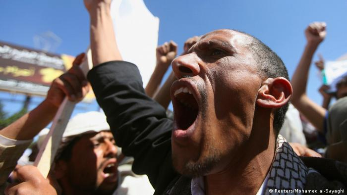 A man shouts slogan during a protest outside the home of Yemeni President Abd-Rabbu Mansour Hadi against the fighting between the Shiite Houthi movement and Salafi militants in the northern town of Damaj, in Sanaa, November 2, 2013. The fighting erupted on Wednesday despite government mediation efforts to shore up a ceasefire in place since late last year in the mountainous Saada province, which has long been outside the control of the central Yemeni authorities. REUTERS/Mohamed al-Sayaghi (YEMEN - Tags: POLITICS CIVIL UNREST)