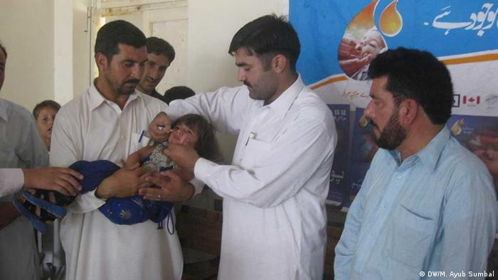 Polio staff vaccinating children at a polio center