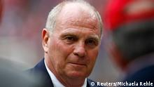File photo of Bayern Munich's president Uli Hoeness before the Uli Hoeness Cup friendly soccer match between Bayern Munich and Barcelona in Munich July 24, 2013. Hoeness was charged with tax evasion November 4, 2013, after months of investigations into the high-profile affair were concluded, a Munich court said. Hoeness, the face of Bayern Munich for many years, stunned Germany in April by saying he had voluntarily alerted tax authorities in January to a Swiss bank account he held, throwing the former West Germany international's future into doubt. REUTERS/Michaela Rehle (GERMANY - Tags: SPORT SOCCER HEADSHOT CRIME LAW BUSINESS)