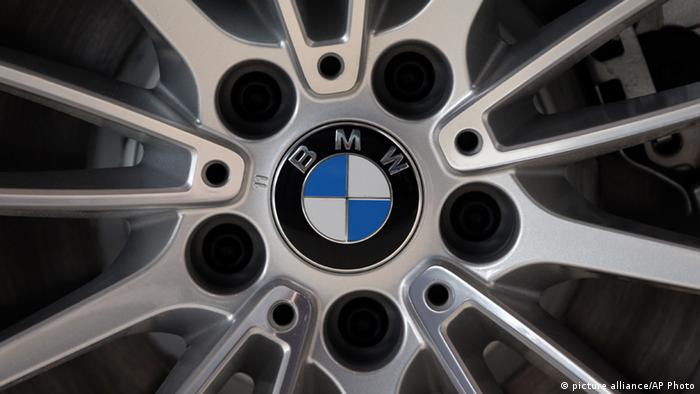 The company logo of car manufacturer BMW is pictured on a car in Munich, Germany (AP Photo/Matthias Schrader)
