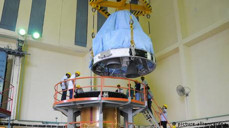 Mars Orbiter Spacecraft or Mangalyaan's fourth stage being hoisted during its integration with the third stage at the Satish Dhawan Space Center Sriharikota in Andhra Pradesh about 80 kilometers from Chennai, India, 04 November 2013. (Photo: EPA/INDIAN SPACE RESEARCH ORGANIZATION )