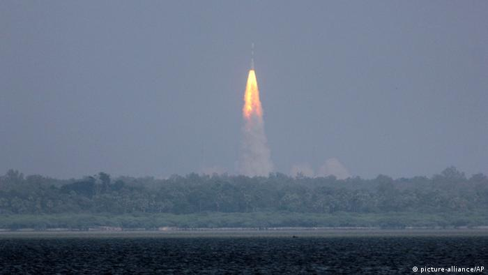 The Polar Satellite Launch Vehicle (PSLV-C25) rocket lifts off carrying India's Mars spacecraft from the east coast island of Sriharikota, India, Tuesday, Nov. 5, 2013. India on Tuesday launched its first spacecraft bound for Mars, a complex mission that it hopes will demonstrate and advance technologies for space travel. The 1,350-kilogram (3,000-pound) Mangalyaan orbiter was headed first into an elliptical orbit around Earth, after which a series of technical maneuvers and short burns will raise its orbit before it slingshots toward Mars. (AP Photo/Arun Sankar K)