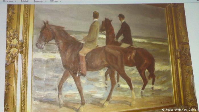 A painting by German artist Max Liebermann 'Zwei Reiter am Strande' (Two Horsemen at the Beach) is beamed to a wall November 5, 2013, at an Augsburg courtroom during a news conference of state prosecutor Reinhard Nemetz and expert art historian Meike Hoffmann from the Berlin Free University. A Jewish group accused Germany on Monday of moral complicity in concealment of stolen paintings after it emerged authorities failed for two years to report discovery of a trove of modern art seized by the Nazis, including works by Picasso and Matisse. Customs officials' chance discovery of 1,500 artworks in a Munich flat owned by Cornelius Gurlitt, the reclusive elderly son of war-time art dealer Hildebrand Gurlitt, who was authorized by Hitler's propagandist minister Joseph Goebbels to sell art the Nazis stole, was revealed in a report by news magazine Focus over the weekend. The art works missing for more than 70 years could be worth well over one billion euros. REUTERS/Michael Dalder (GERMANY - Tags: ENTERTAINMENT CRIME LAW POLITICS SOCIETY)