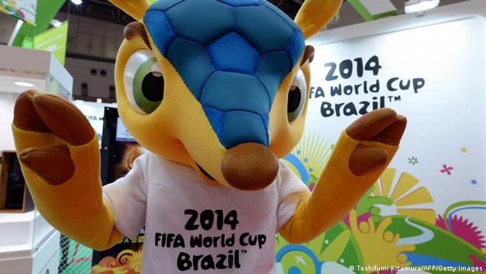 FIFA 2014 World Cup Brazil football mascot, 'Fuleco' gestures to visitors at the official goods booth in the Tokyo International gift show on September 4, 2013. About 200,000 visitors are expected during the three day exhibition in which 2,500 companies are taking part. AFP PHOTO / TOSHIFUMI KITAMURA (Photo credit should read TOSHIFUMI KITAMURA/AFP/Getty Images)