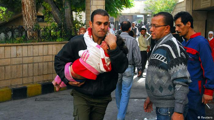 ATTENTION EDITORS - VISUAL COVERAGE OF SCENES OF INJURY OR DEATH A man carries an injured child after a bomb explosion in front of the al-Hejaz train station in central Damascus November 6, 2013 in this picture provided by Syria's national news agency SANA. A bomb exploded in central Damascus on Wednesday, killing eight people and wounding 50, with women and children among the casualties, SANA said. REUTERS/SANA/Handout via Reuters (SYRIA - Tags: CONFLICT CIVIL UNREST TPX IMAGES OF THE DAY) ATTENTION EDITORS - THIS IMAGE WAS PROVIDED BY A THIRD PARTY. FOR EDITORIAL USE ONLY. NOT FOR SALE FOR MARKETING OR ADVERTISING CAMPAIGNS. THIS PICTURE IS DISTRIBUTED EXACTLY AS RECEIVED BY REUTERS, AS A SERVICE TO CLIENTS. TEMPLATE OUT