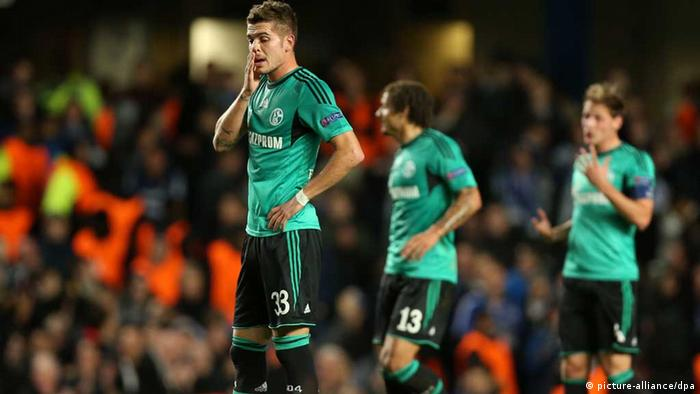 Schalke's Roman Neustaedter (L) looks dejected during the UEFA Champions League group E soccer match between Chelsea FC and FC Schalke 04 at Stamford Bridge Stadium in London, Britain, 06 November 2013. Photo: Friso Gentsch/dpa